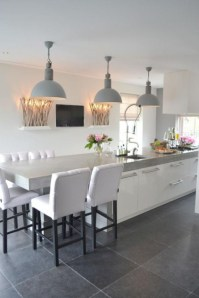 Fascinating kitchen islands ideas with seating and dining areas (36)