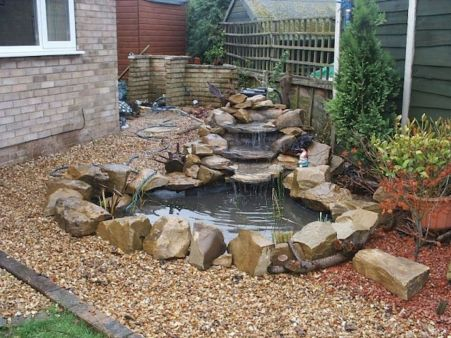Small backyard waterfall design ideas 06