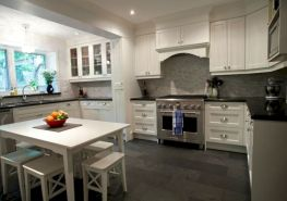 Cozy white kitchen with dark floors 03