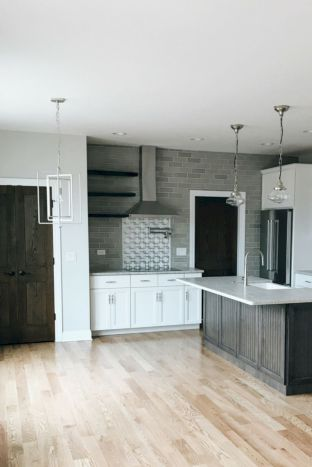 Cozy white kitchen with dark floors 10