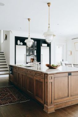 Cozy white kitchen with dark floors 24