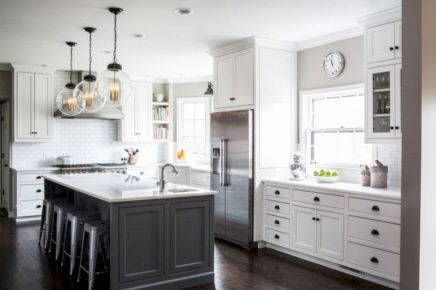 Cozy white kitchen with dark floors 25