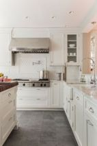 Cozy white kitchen with dark floors 27
