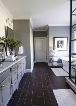 Cozy white kitchen with dark floors 32