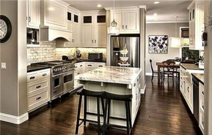 Cozy white kitchen with dark floors 34