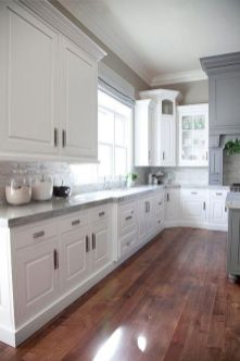 Cozy white kitchen with dark floors 40
