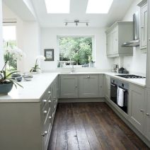 Cozy white kitchen with dark floors 42