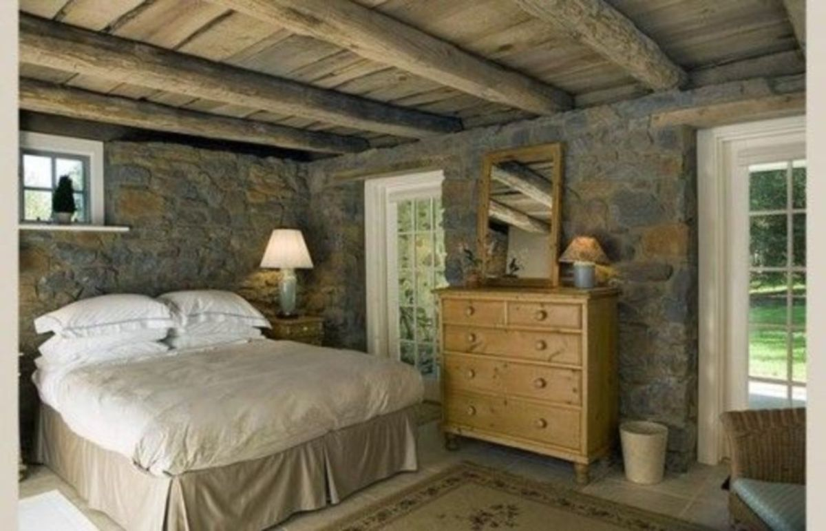 Pretty bedroom designs ideas with exposed wooden beams 26