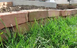 Elegant backyard landscaping ideas using bricks 26
