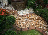 Elegant backyard landscaping ideas using bricks 31