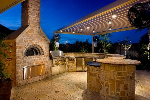 Romantic rustic outdoor kitchen designs with fireplace 20