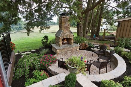 Romantic rustic outdoor kitchen designs with fireplace 54