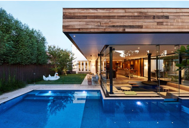 Impressive pool house features a sunken living room with a spa around 1