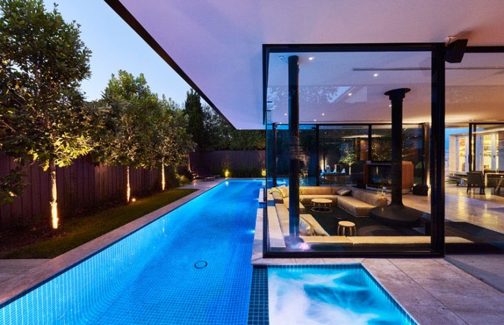 Impressive pool house features a sunken living room with a spa around 2
