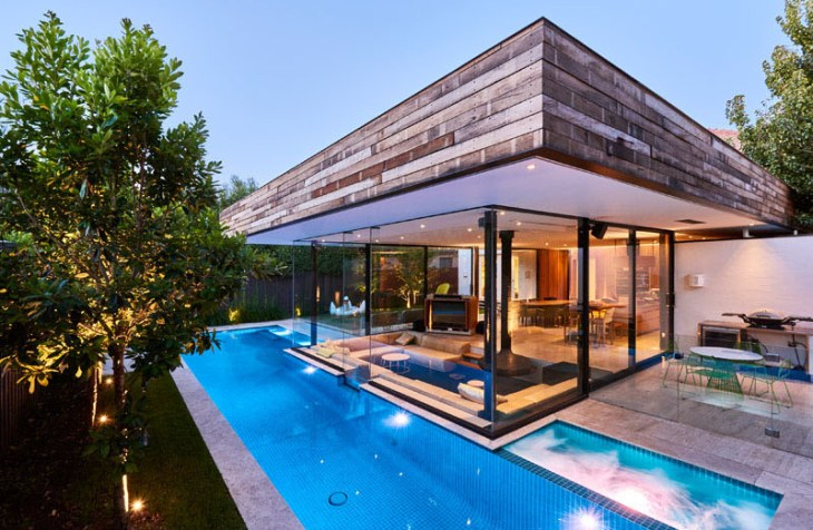 Impressive pool house features a sunken living room with a spa around 3