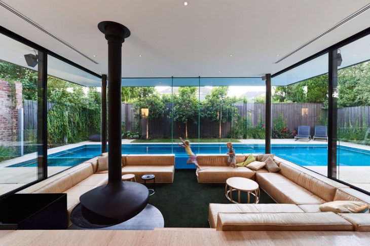 Impressive pool house features a sunken living room with a spa around 5