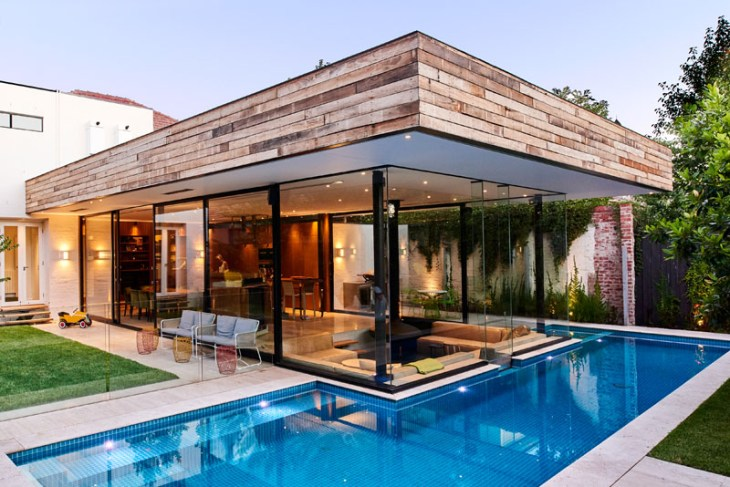 Impressive pool house features a sunken living room with a spa around 6