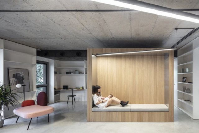 Comfy apartment design with a wooden box for a young family with kids 1