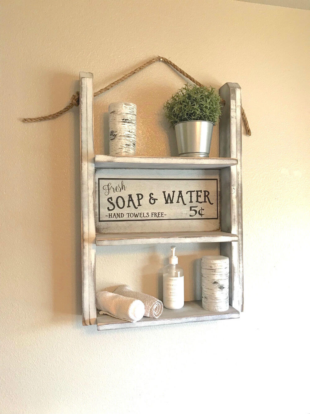 Red roan signs farmhouse bathroom shelf https://homebnc.com/best-etsy-bathroom-accessories-ideas-to-buy/