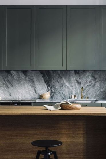 03-sage-cabinets-a-grey-marble-backsplash-and-a-wooden-kitchen-island-compose-a-chic-and-refined-modern-look