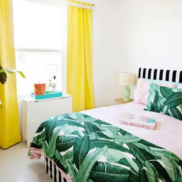 05-bright-colors-plus-a-vintage-banana-leaf-print-bedspread-and-pillows-for-a-playful-summer-bedroom