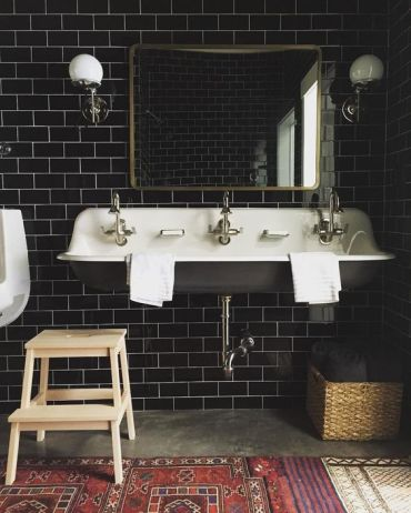 07-black-subway-tiles-become-a-focal-point-and-create-a-mood-in-this-vintage-bathroom