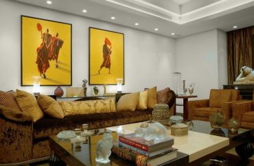 Contemporary-living-space-with-recessed-lighting-shedding-soft-hues-on-wall-art