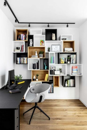 Mismatching-box-wall-mounted-shelving-units-double-as-decoration-in-a-home-office