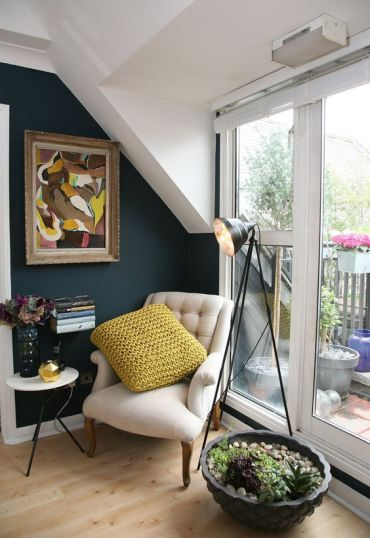 04-a-cozy-reading-nook-by-the-window-with-an-artwork-succulents-and-a-small-side-table