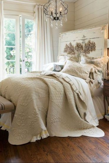 10-a-bed-with-an-oversized-whitewashed-headboard-and-a-gorgeous-crystal-chandelier