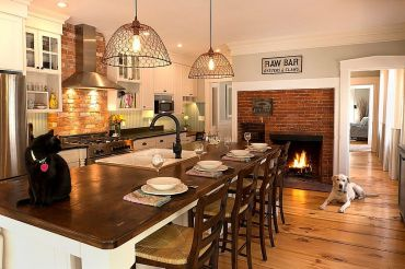 Traditional-brick-fireplace-serves-both-the-kitchen-and-the-breakfast-zone
