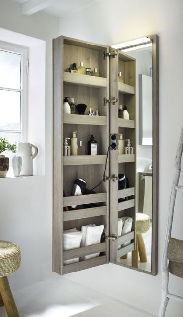 11-a-comfortable-storage-piece-with-a-mirror-door-is-a-popular-option-for-bathrooms