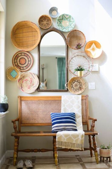 23-give-your-entryway-a-bold-summer-feel-with-a-wall-of-decorative-baskets-painted-and-printed-ones-and-a-striped-pillow