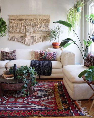 06-colorful-printed-pillows-a-printed-rug-and-a-large-macrame-hanging-make-the-space-boho-like