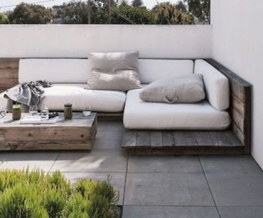 08-a-weathered-corner-wood-seating-with-white-cushions-and-pillows