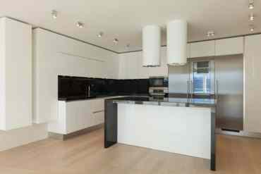 Open-layout-black-and-white-kitchen-10