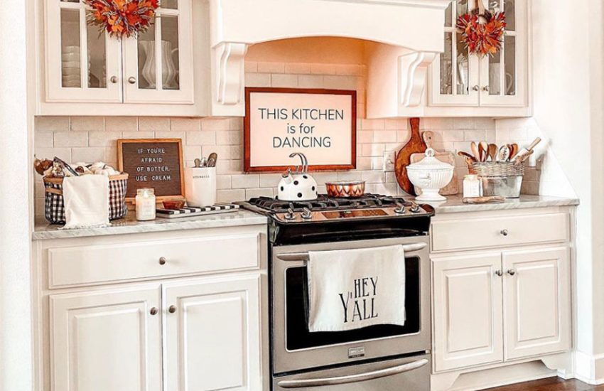 Black-and-white-plaid-rug-in-white-kitchen-with-fall-decor-894x1024