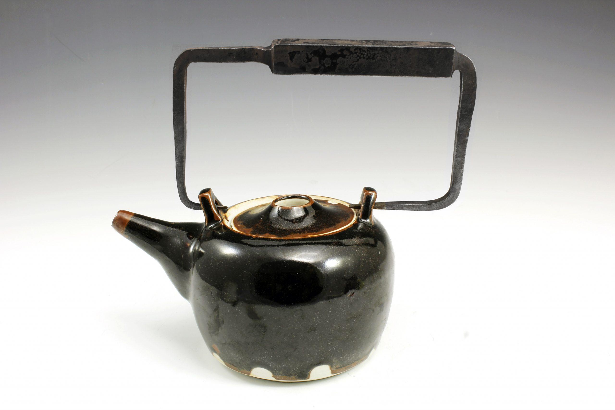 forged iron and ceramic teapot liza mitrofanova