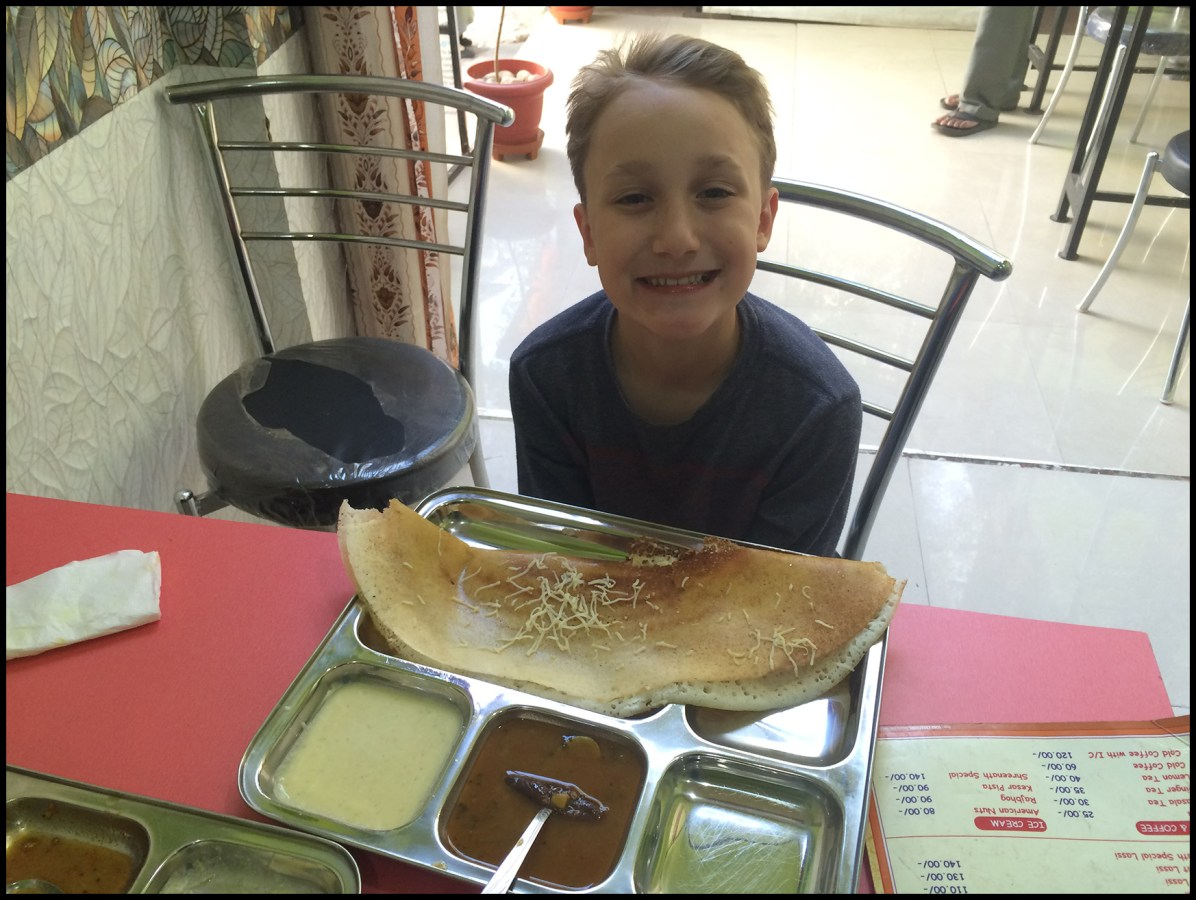 Eating a Dosa twice the size of my head! YUM!