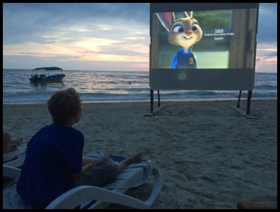 Watching a movie on the beach at sunset