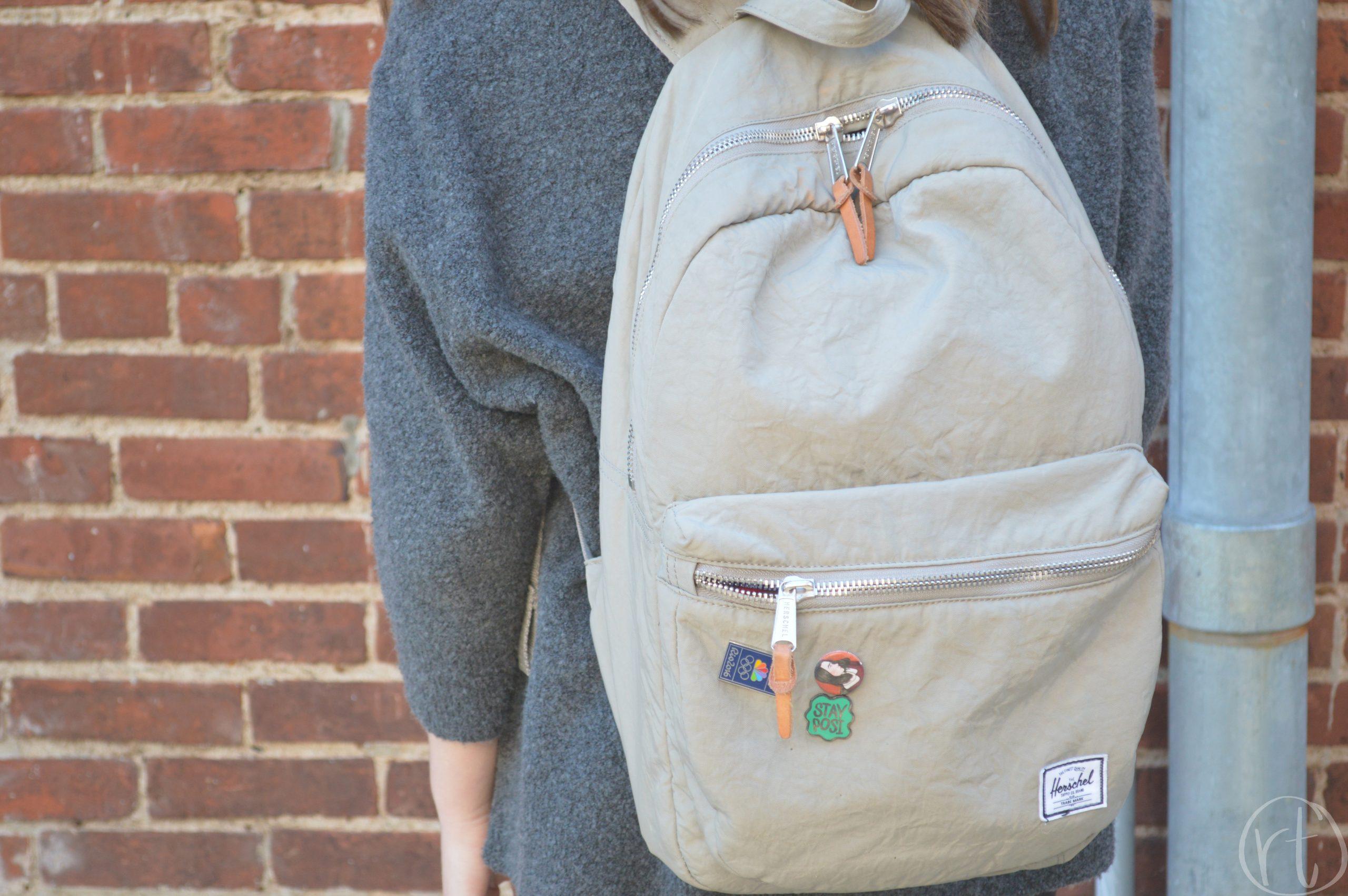how-to-wear-a-travel-backpack-herschel-pins-round-trip-travel
