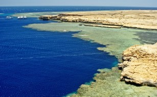 Coral reefs and blue deep waters of the Red Sea