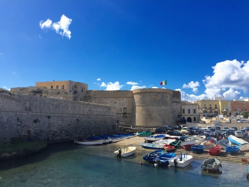 Gallipoli's old town walls and a fishing boats