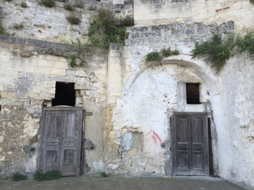 Entrances to some caves are still boarded up like these two in Sassi Caveso