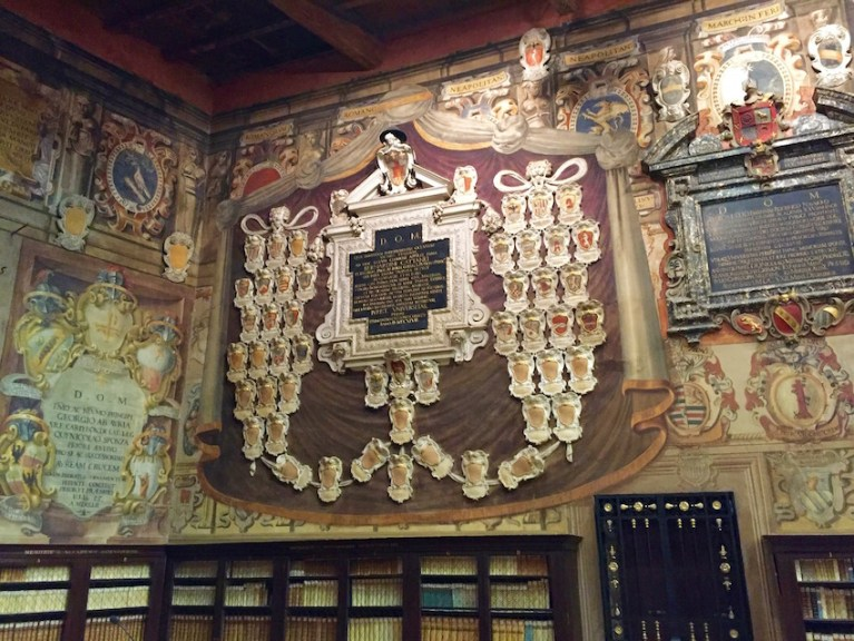 Civic Library Bologna and a wall of coat of arms