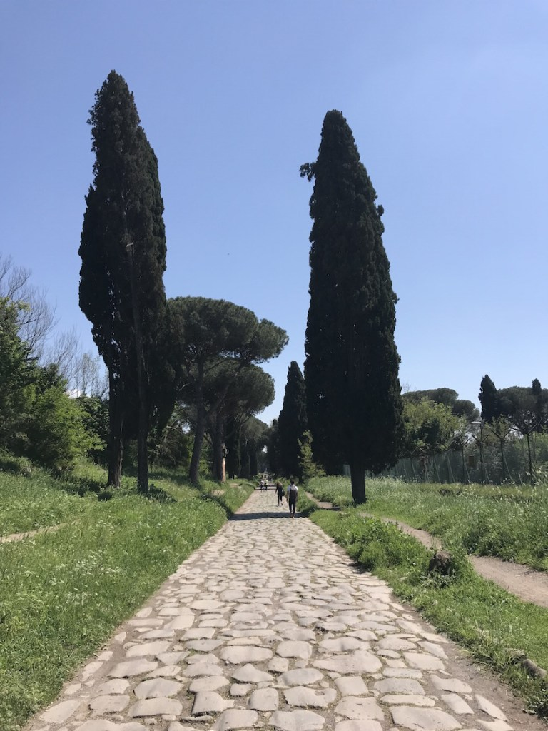 walking the appian way and its huge cobblestones