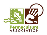 the permaculture association logo, a brown hand and a green leaf on a white background