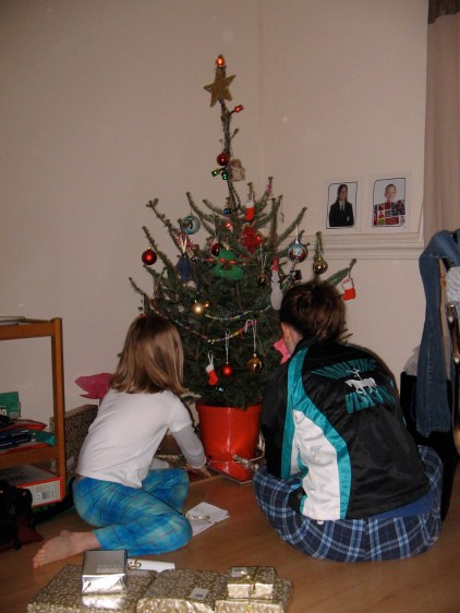 Girls check out gifts Christmas morning