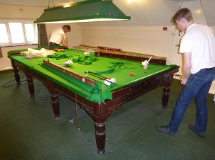 Fitting a new cloth to the snooker table