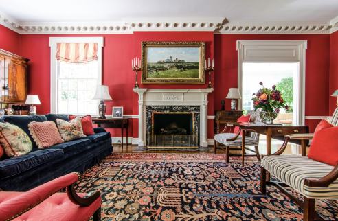 Bold Red Walls In Traditional Living Room